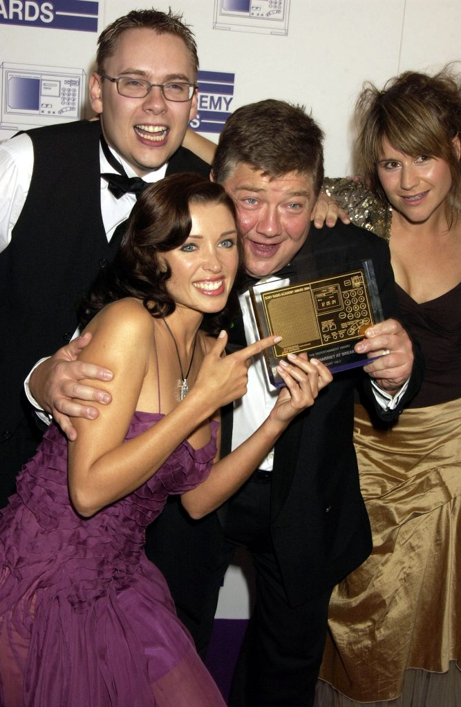 """LONDON -  MAY 12: (EMBARGOED FOR PUBLICATION IN UK TABLOID NEWSPAPERS UNTIL 48 HOURS AFTER CREATE DATE AND TIME)   Jono Colman, Dannie Minogue and Harriet Scott pose at the """"Sony Radio Academy Awards"""" at Grosvenor House, Park Lane on May 12, 2004 in London. The prestigious awards are for national and regional radio stations, broadcasters in the public and commercial sectors, and radio stations' digital and internet services.  (Photo by Dave Benett/Getty Images)"""