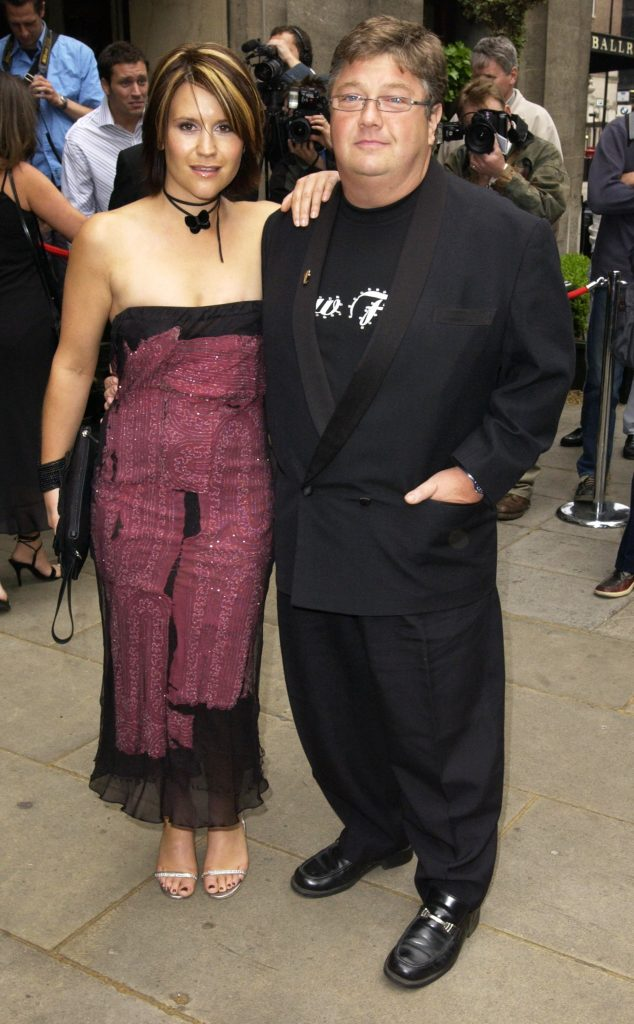 LONDON - MAY 8:  Radio DJ Jonno Coleman (R) with guest Harriet attend the Sony Radio Awards at The Grosvenor Hotel on May 8, 2003 in London, England.  (Photo by Bruno Vincent/Getty Images)